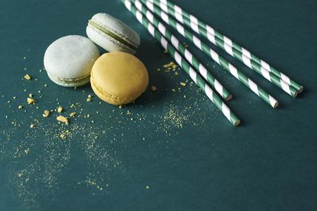 Three macaroons and few straws Stock Photo