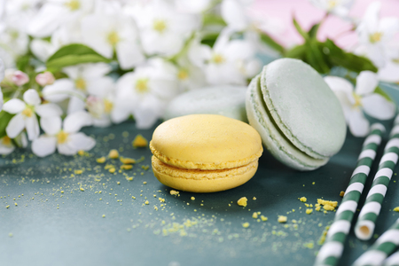 Arrangement of sweet food and flowers Stock Photo