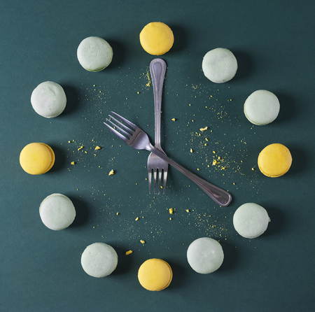 Modern clock done with forks and macaroons