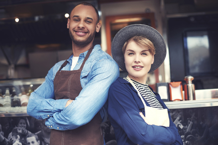 business finance: Portrait of couple selling food on the street Stock Photo