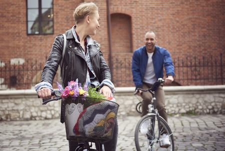 Couple racing with bikes on the cobbled street
