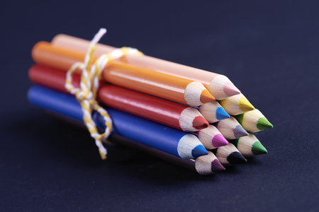 Colored pencils tied up with ribbon Stock Photo