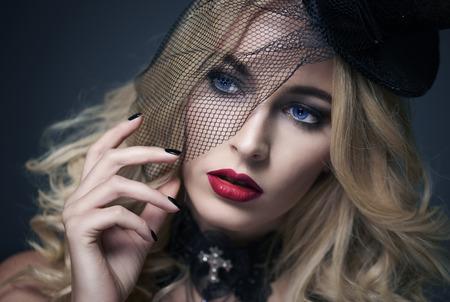 Pretty face of woman wearing black veil