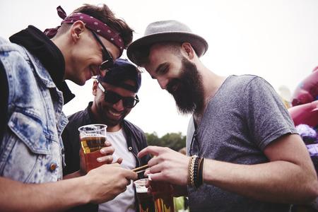 Men talking at the summer festival