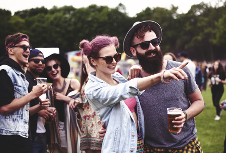 Couple standing in crowd at music festival