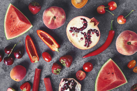 Red vegetable and fruit on the gray background