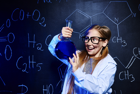 Happy little scientist making experiment Banco de Imagens