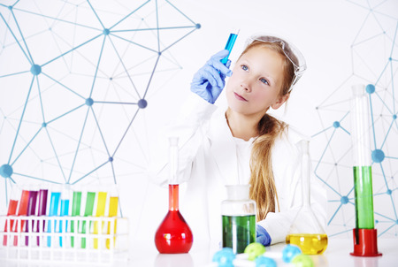 Little specialist in chemical laboratory Stock Photo