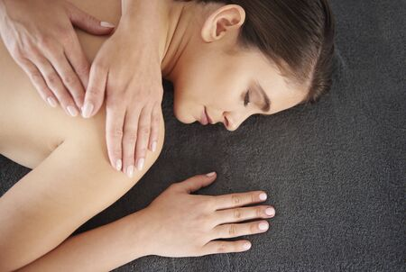 healthy body: Woman relaxing during the massaging Stock Photo