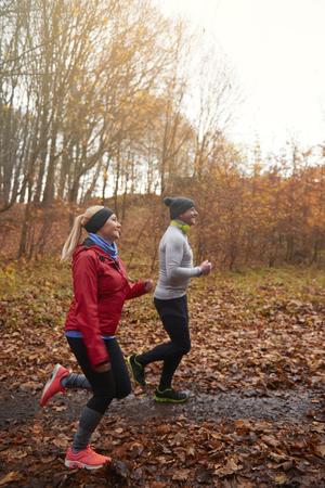 Full length of two jogging seniors