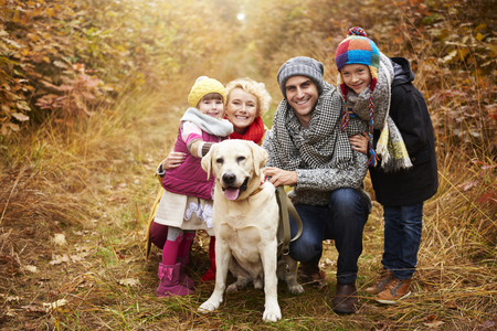 Portrait of family in forest path Stock Photo - 82526423