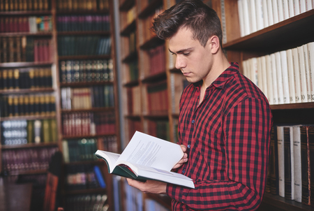 Man browsing a book in library
