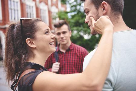 Smiling, crazy woman accostting man Stock Photo