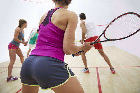 Group of unrecognizable people playing squash