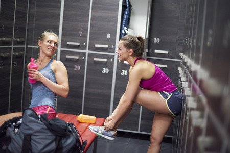Two women preparing for the training at the gym Stok Fotoğraf