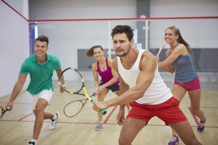 Group of best friends during the squash match Foto de archivo
