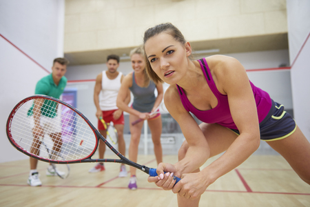 Group of friends playing squash