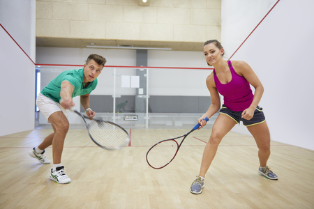 Squash match between young couple