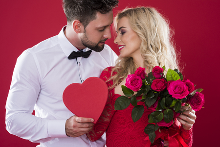 Romantic scene on the red background Archivio Fotografico