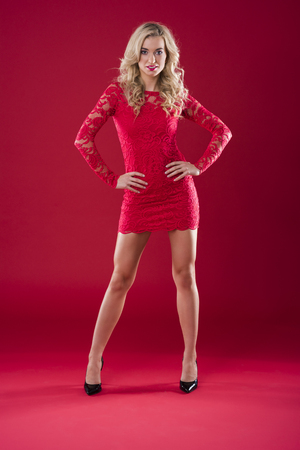 Attractive woman on the red background