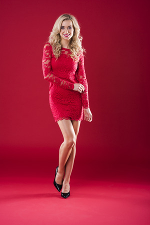 Attractive woman in red lace dress Stock Photo
