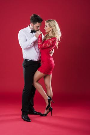Gentelman kissing hand of his girlfriend Stock Photo