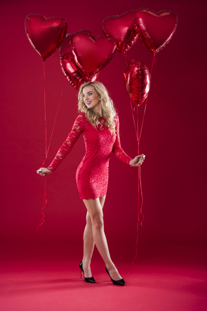 Woman holding balloons in both hands Stock Photo