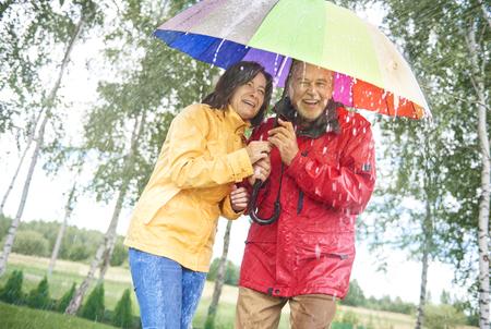 Couple with a rainbow umbrella Stock Photo