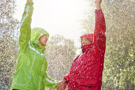Couple holding hands in the rain