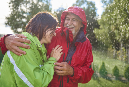 Couple having romantic time in the rain