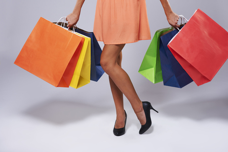 Low section of woman with paper bags Stock Photo