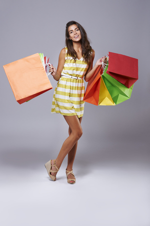 Abundance of shopping bags in womans hands Stock Photo