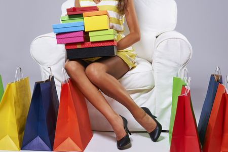 Abundance of shopping bags around the woman