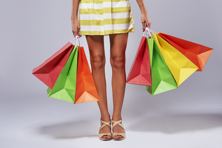 Both hands full of shopping bags Stock Photo