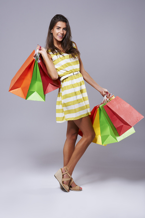 Girl bending with bags after shopping Stock Photo