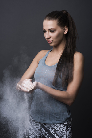 Using white powder before exercising Stock Photo
