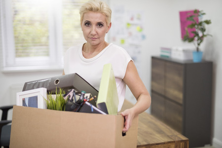 Fired woman with box full of personal things