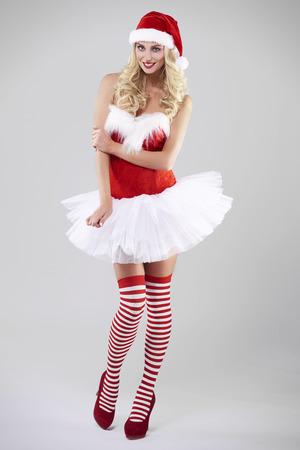 Woman dressed in full santa clothing Stock Photo