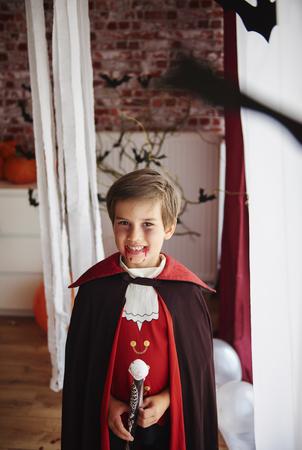 Boy dressed as a vampire