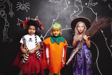 Happy friends wearing halloween costumes
