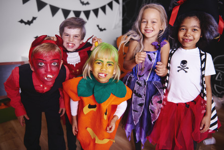 Kids posing  in halloween costume