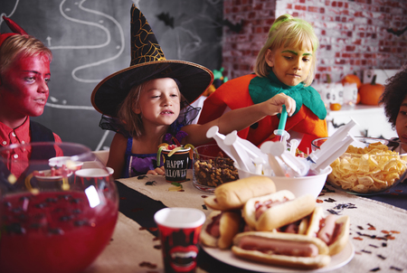 Kids eating at halloween party
