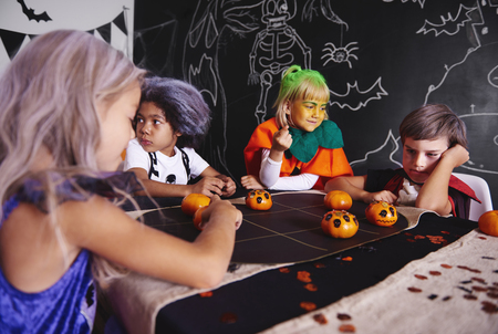Kids playing games while halloween party Banco de Imagens