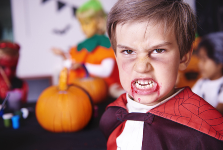 Portrait of boy dressed as a vampire Stock Photo