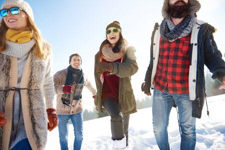 non: Group of friends having winter activities