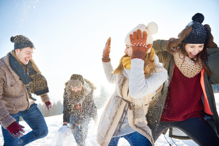 Snow fight between two couples Stockfoto