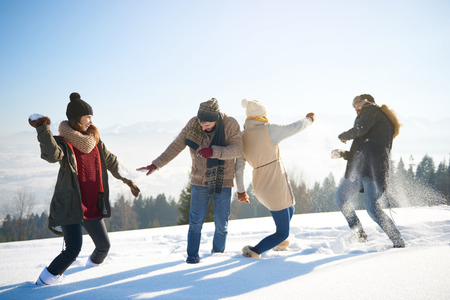 Friends having a funny snow fight