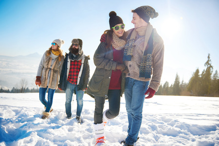 non: Two couples going for a winter walk