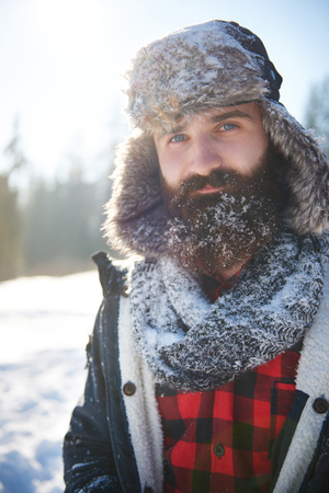 Man with some snow on his beard