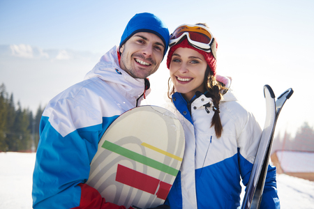 Snowboarders couple over winter vacations